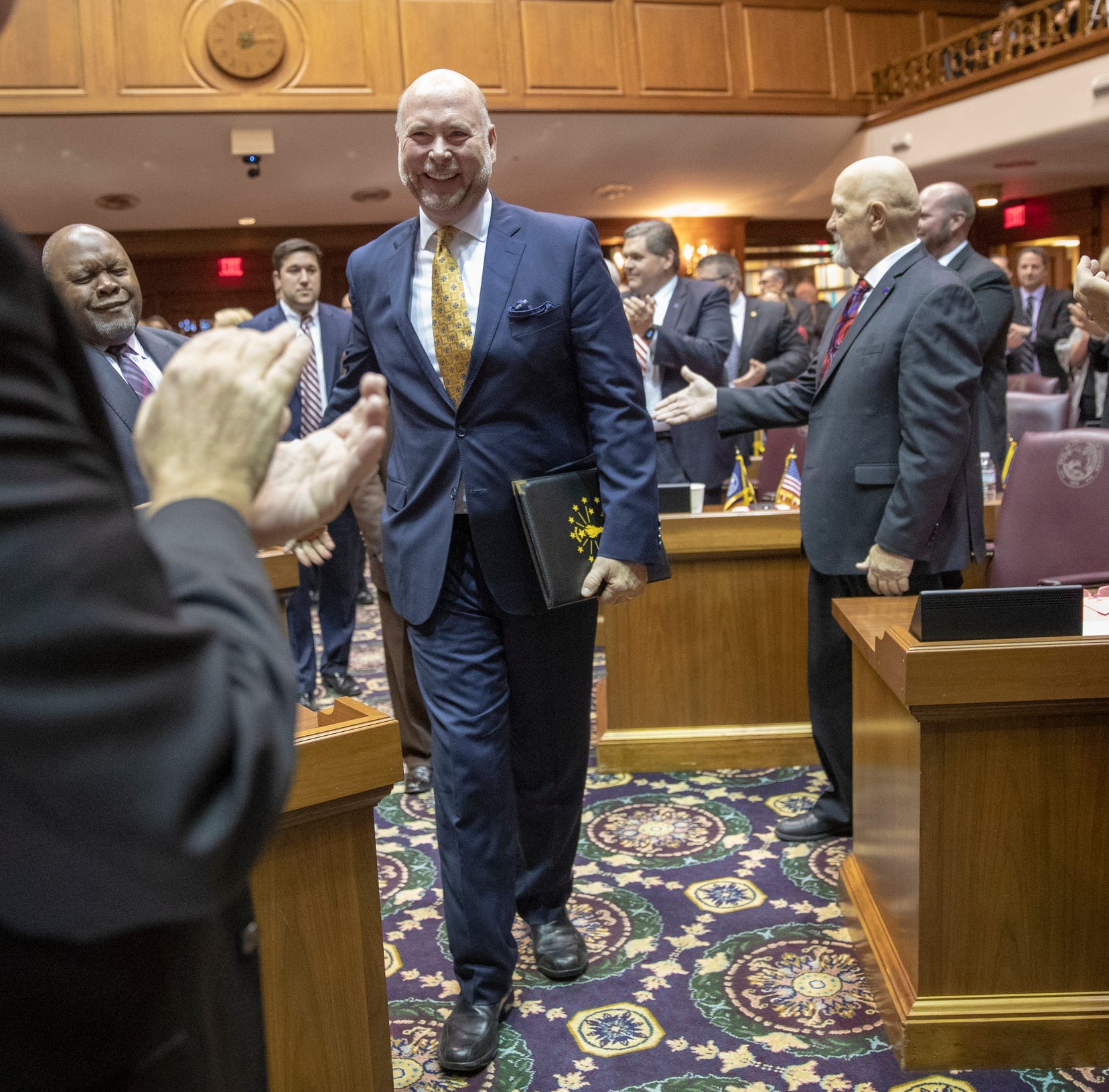 Brian Bosma, walks the aisle after being introduced as Speaker of the House on the day of the start to the legislative session, Indiana Statehouse, Indianapolis, Tuesday, Nov. 20, 2018.