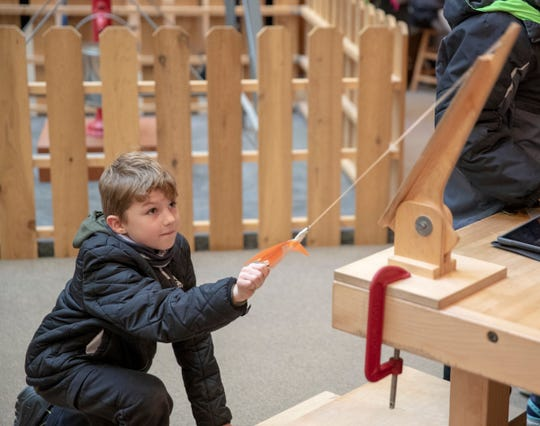 Collin Henderson, tests out a propulsion device at Conner Prairie, Fishers, Monday, Nov. 19, 2018. The learning lab lets local fourth graders study new things at the immersive facilities at the living history museum which has promoted Science, Technology, Engineering and Math fields in recent years.