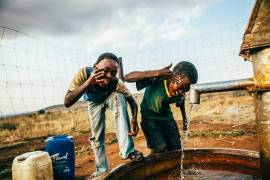 Children drink and wash their faces from a well installed by Thirst Project to provide the community with access to safe drinking water. Thirst Project is a global nonprofit — founded by an Indy native — working to end the clean water crisis by tapping into the power of youth around the country.