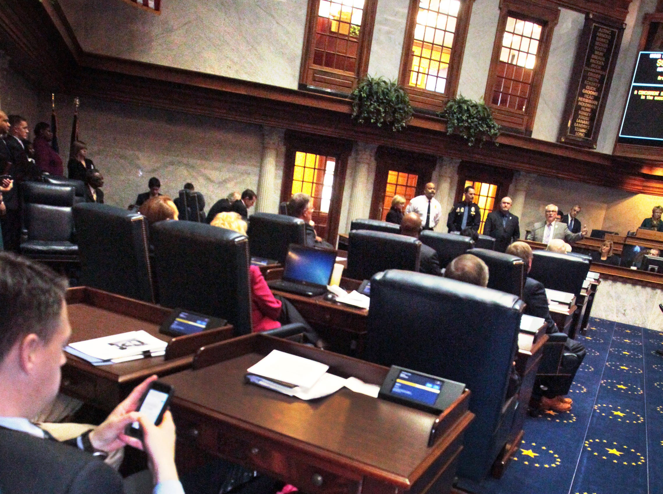 Four-year-old Lilly Banks plays under the desk of her father, Sen. James Banks, R-Columbia City, as he and his colleagues in the Indiana General Assembly take care of business on Organization Day at the Statehouse on Tuesday, Nov. 19, 2013. This is the second Organization Day for Lilly, who is the oldest of Banks' three daughters. Charlie Nye / The Star.