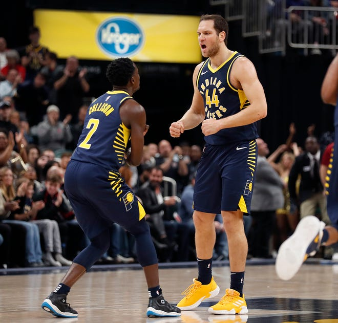 Indiana Pacers forward Bojan Bogdanovic (44) and Darren Collison (2) celebrate jumping out to a large lead over the Utah Jazz in the first half of their game on Monday, Nov. 19, 2018.