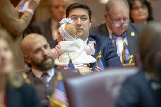 Rep. Ryan Hatfield, holds a baby on the day of the start to the legislative session, Indiana Statehouse, Indianapolis, Tuesday, Nov. 20, 2018.