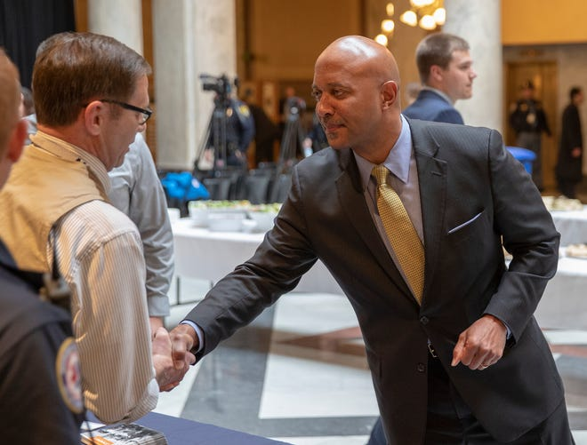 Curtis Hill shakes a hand before a press conference at the start to the legislative session, Indiana Statehouse, Indianapolis, Tuesday, Nov. 20, 2018. Hill has been accused of inappropriately touching four women at a party earlier this year.