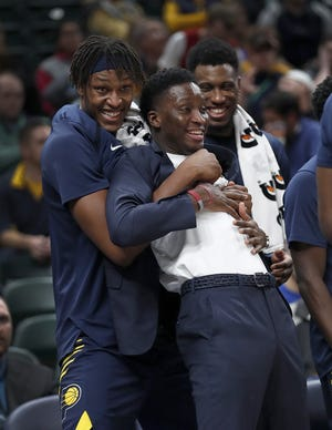 Indiana Pacers center Myles Turner (33) and  Victor Oladipo begin to celebrate on the bench in the second half of their game on Monday, Nov. 19, 2018. The Pacers defeated the Jazz 121-94.