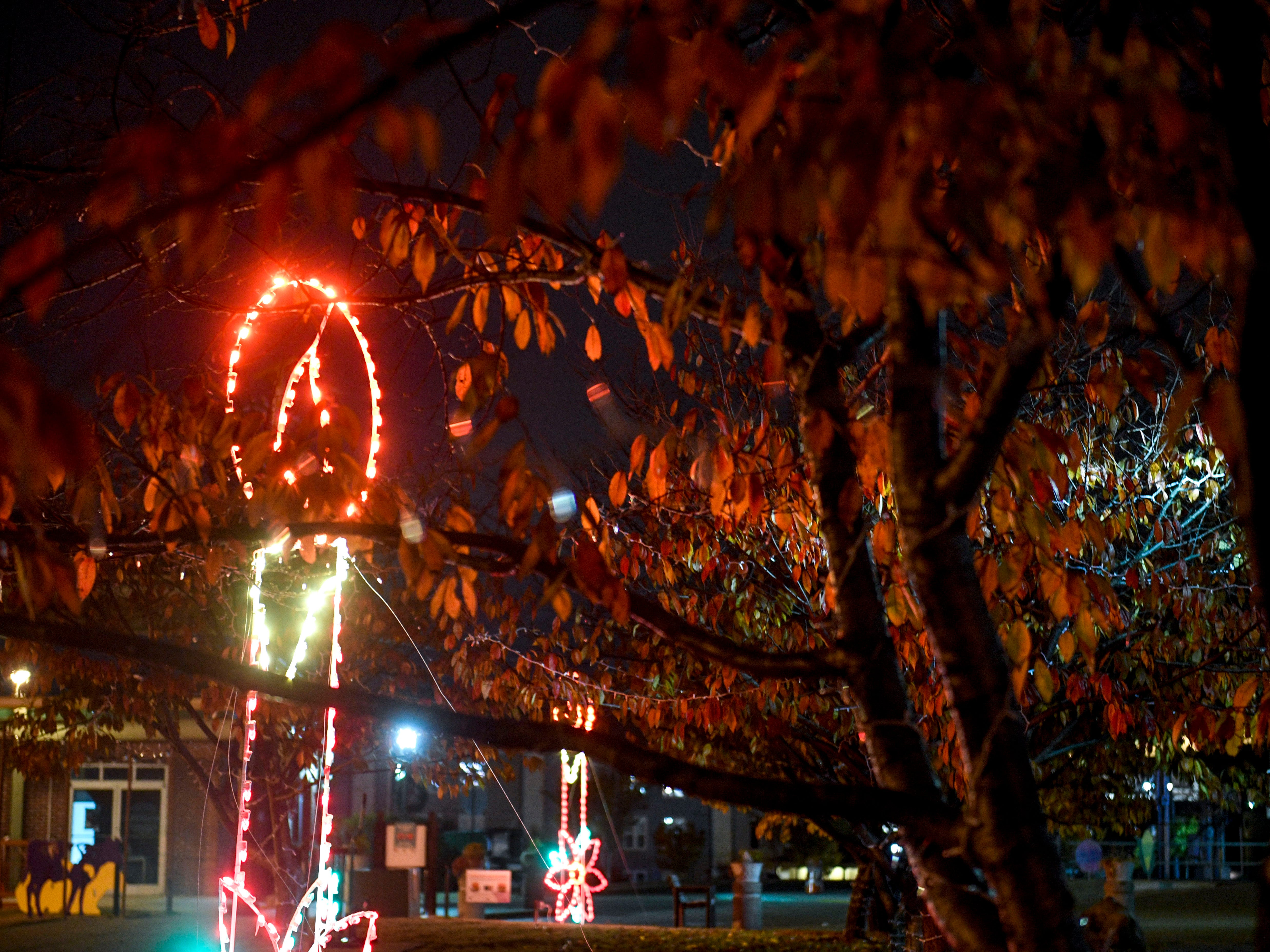 Holiday displays celebrating the Christmas season including wreaths, lighting displays, and Santa's house can be seen set up throughout Downtown in Jackson, Tenn., on Monday, Nov. 19, 2018.