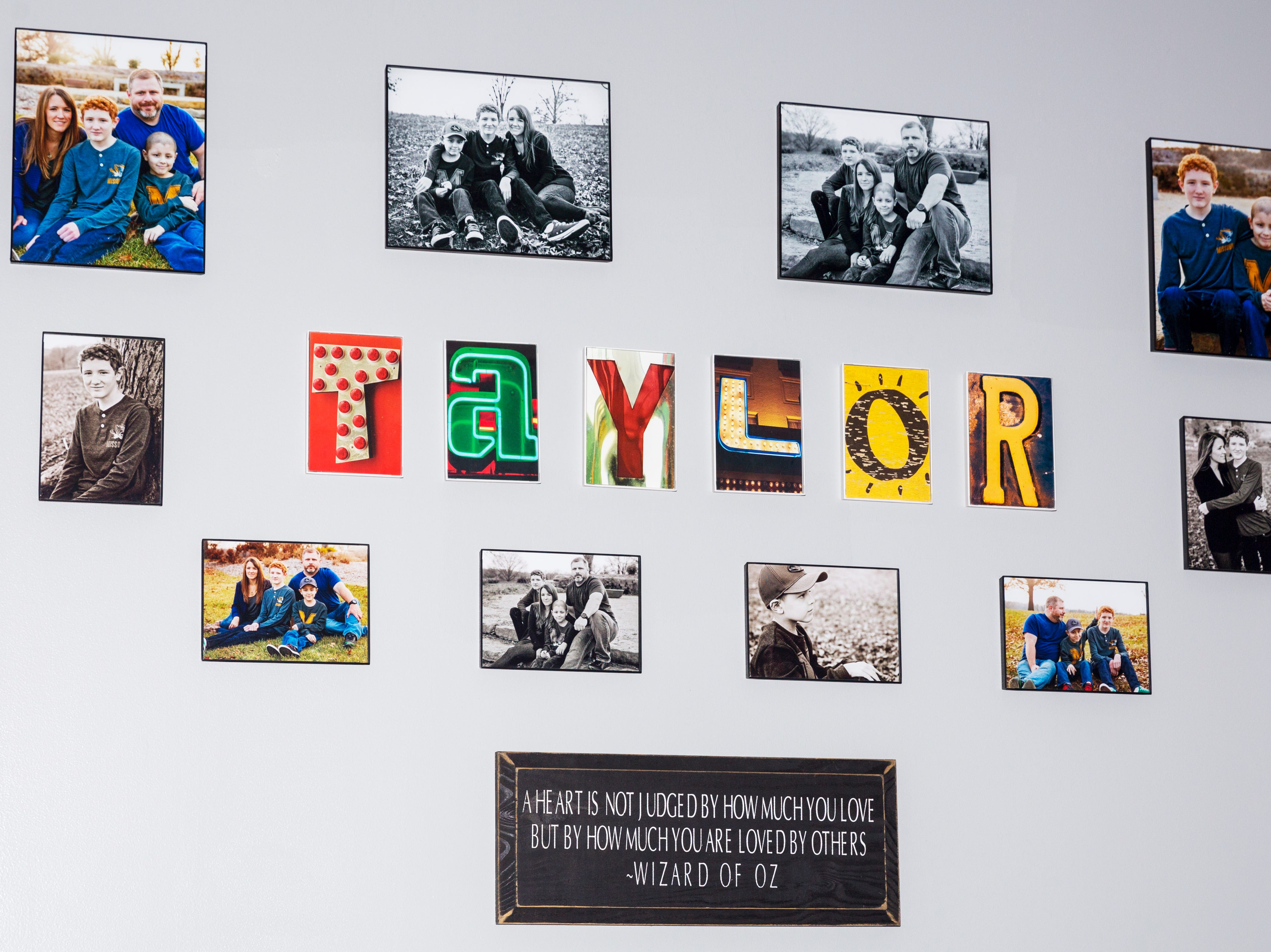 Family photographs fill one wall of the Taylor family's living room in Jackson, Tenn.