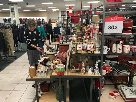 Holiday gear, clothing and other specials are ready for Black Friday shoppers at Stein Mart. Assistant Manager Babs Richardson tweaks a display before the big day.