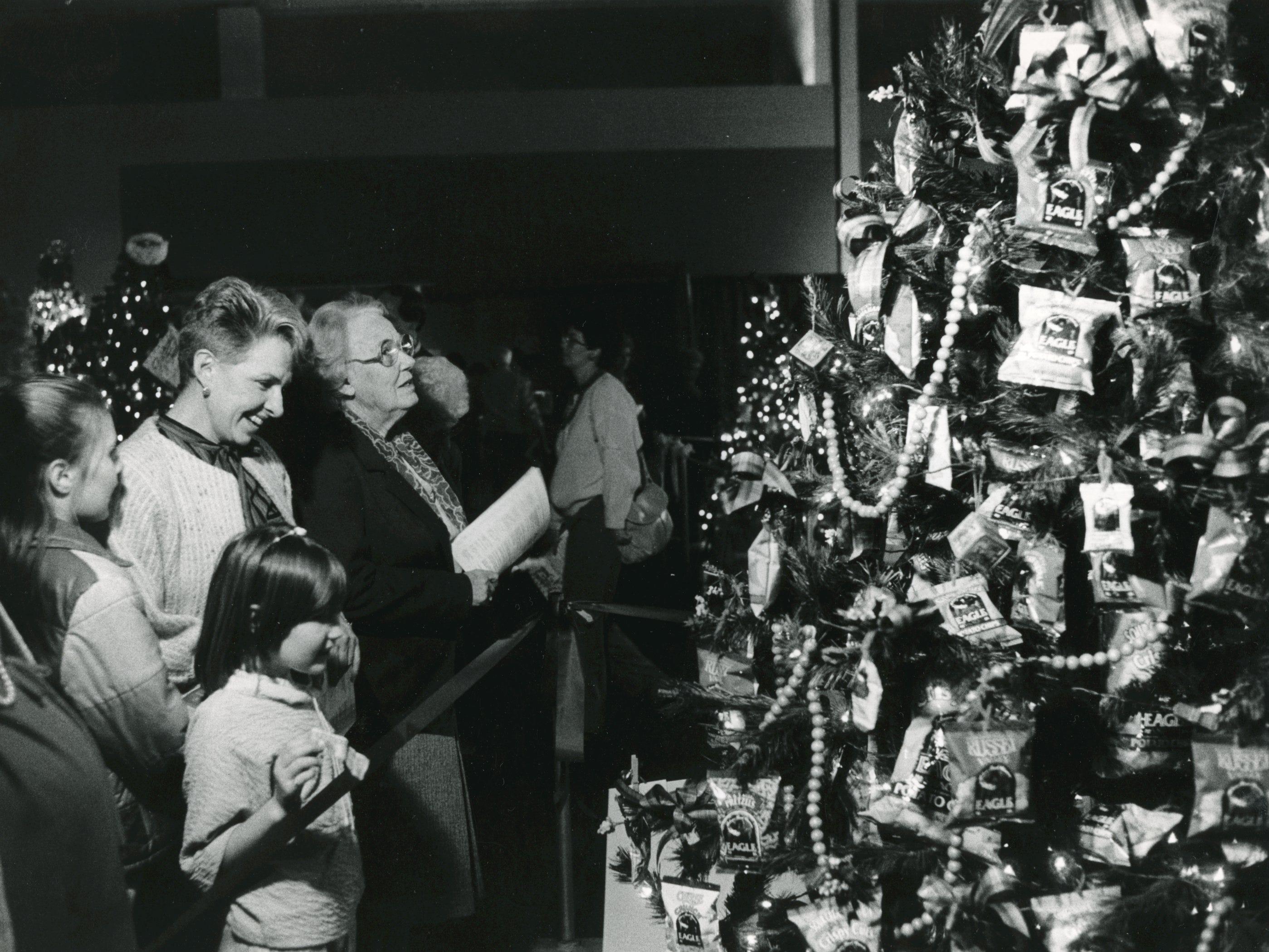 Spectators enjoy one of the many Christmas trees on display at Fantasy of Trees, November, 1986.