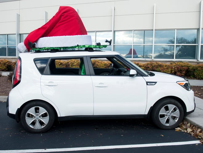 David Weech's Christmas-themed Kia Soul outside of the Knoxville News Sentinel on Tuesday, November 20, 2018. Weech drives his car for Uber and Lyft.