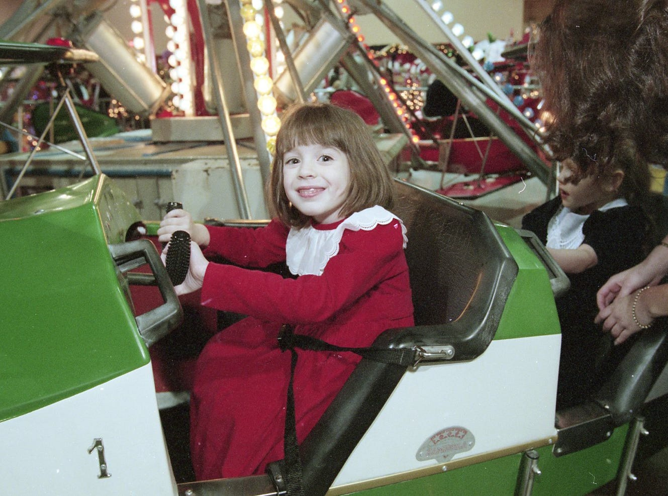 Janie McDaniel flies the airplane ride at the Fantasy of Trees opening night gala, 1996.