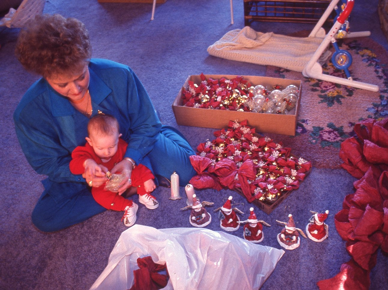 Debbie Kerley and her son, Adam, go through various Christmas tree decorations in preparation for the Fantasy of Trees event, November, 1990.