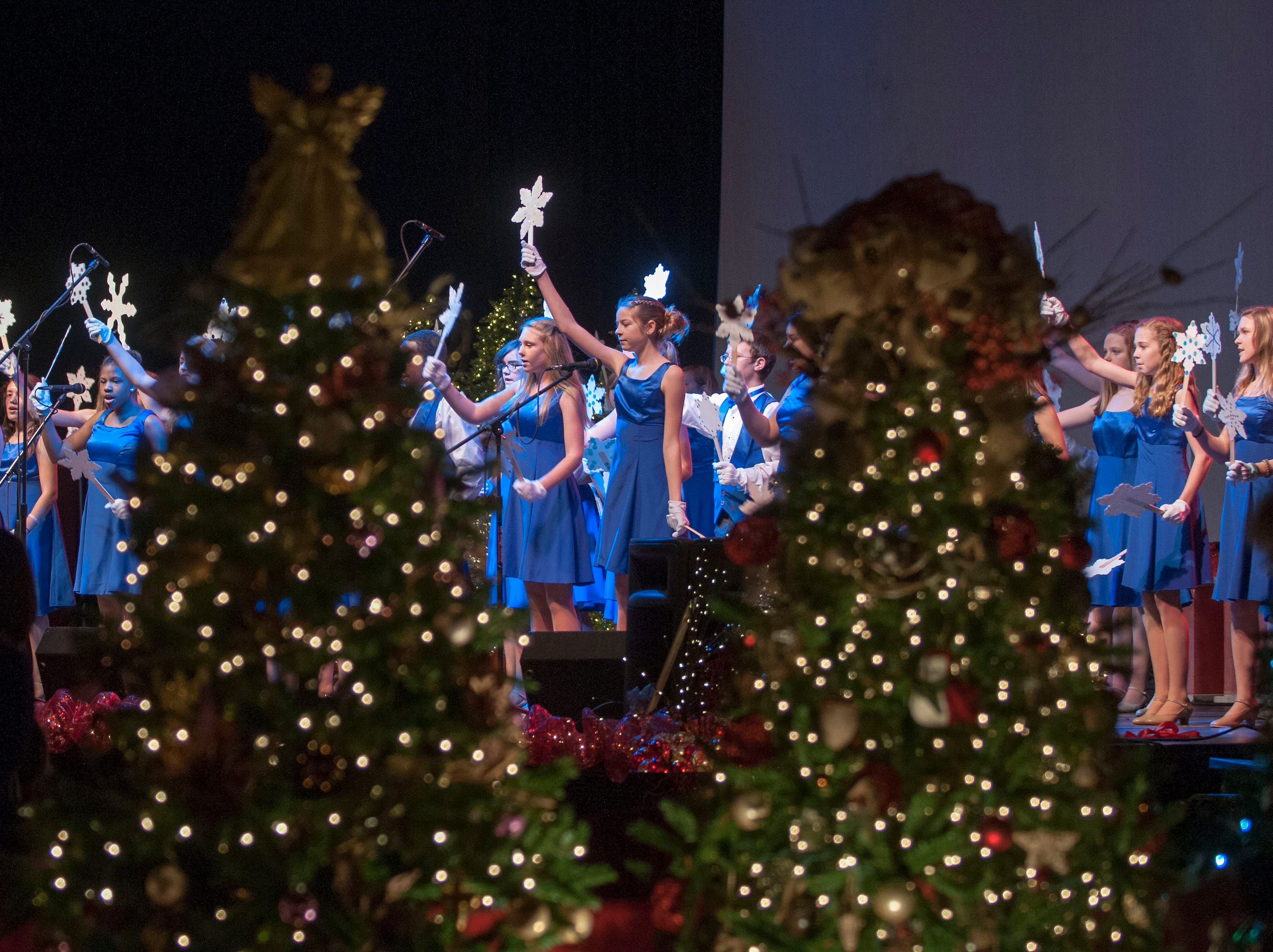 Students from Jefferson Middle School perform on the stage at the 28th Annual Fantasy of Trees. The 28th Fantasy of Trees once again transforms the downtown Knoxville Convention Center into a winter wonderland of decorated trees, gingerbread houses, holiday shops and children's activities, helping move Thanksgiving week into the Christmas season. ( J. MILES CARY/NEWS SENTINEL )