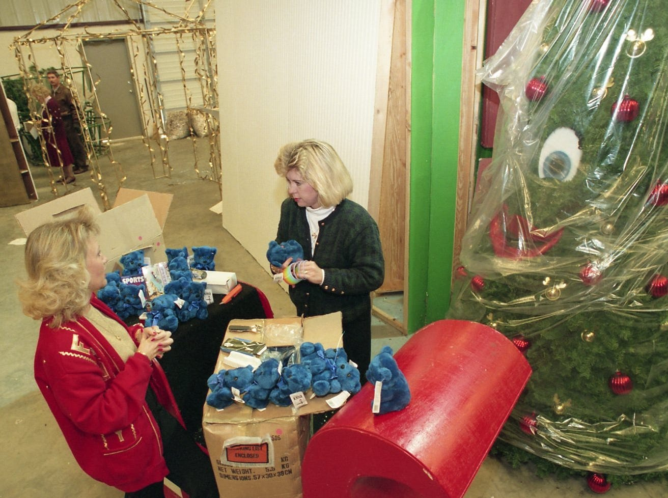 Debbie Mackey and Debbie Dean decorate a tree for Fantasy of Trees, 1995.