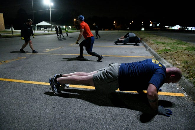 F3 Knoxville men exercising Tuesday, Nov. 20, 2018 in the parking lot of Powell High School. F3 stands for fitness, fellowship, and faith and is multiple groups of men who gather in nine locations around Knoxville for accountability and exercise.