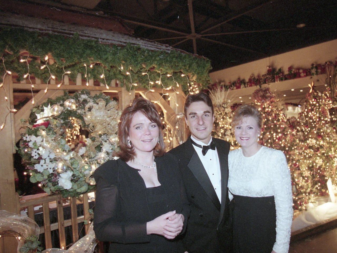 WIVK morning show personalities Alison West, Andy Ritchie and his wife Angie Ritchie, Fantasy of Trees gala, 1997.