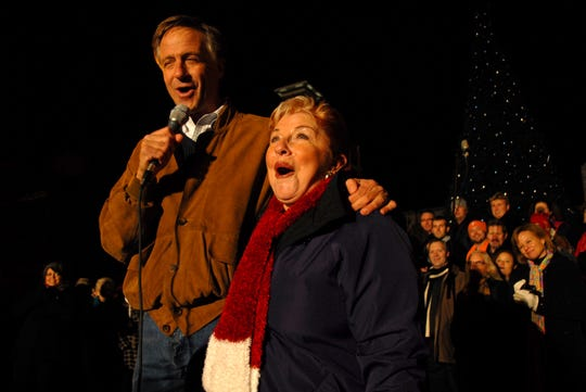 Then Knoxville Mayor Bill Haslam commends City of Knoxville Special Events Director Mickey Mallonee for her years of service at the Regal Celebration of Lights in downtown Knoxville on Nov. 26, 2010. Mallonnee retired from her post that year. It was the 10th Christmas in the City that she had organized.