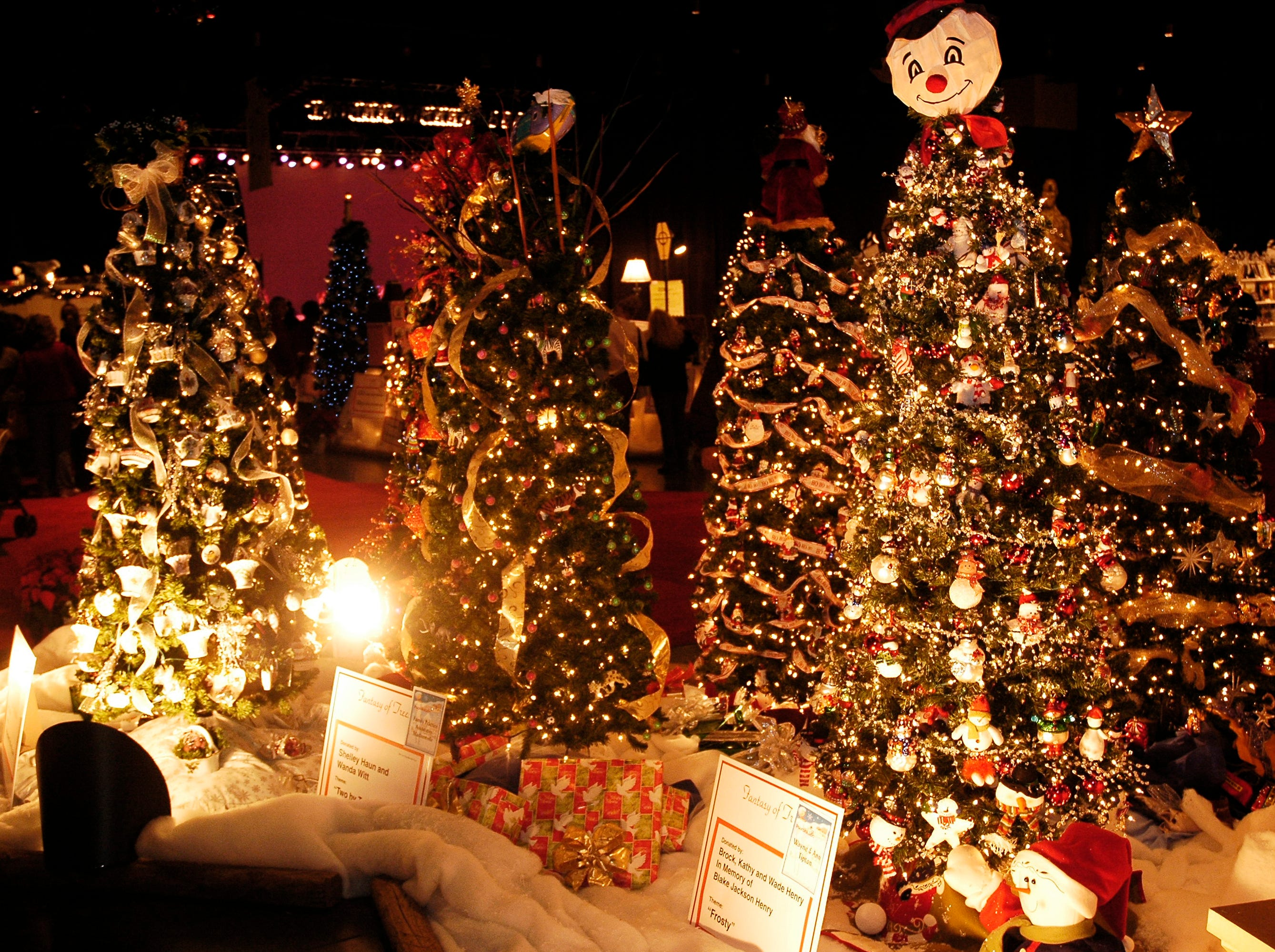 """Living--News Sentinel photo by Bryan Campbell--Decorated trees at the 21st annual Fantasy of Trees at the Knoxville Convention Center, a fund raiser for the East Tennessee Childrens Hospital.  The tree titled """"Frosty"""" was donated by Brock, Kathy, and Wade Henry.  11/26/05"""