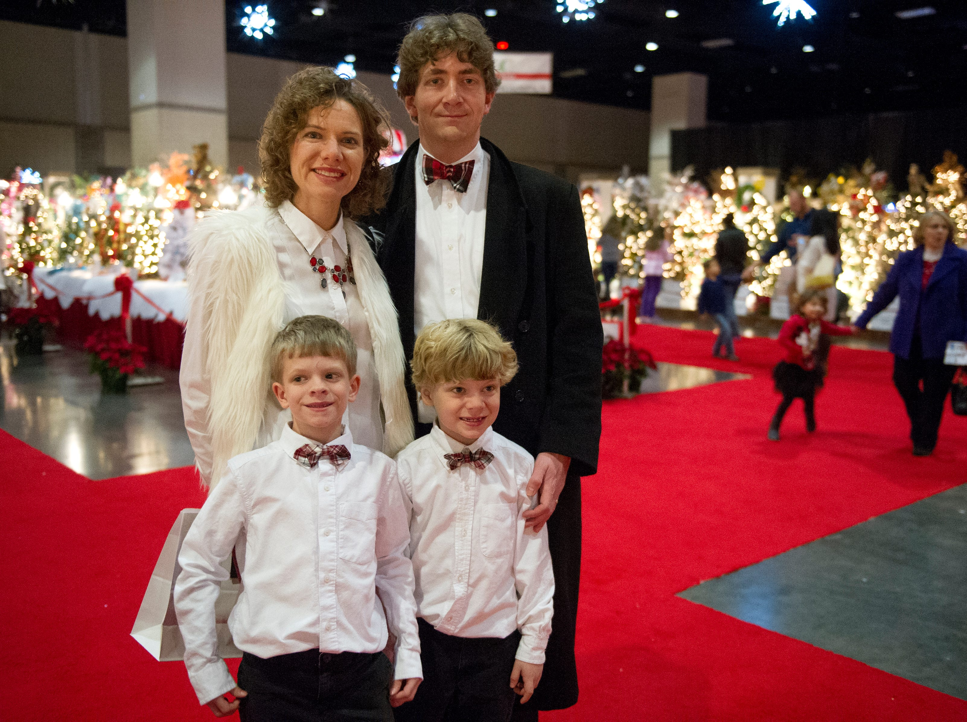Amy Shewmake(from top left ), Tripp Shewmake, Hunter Shewmake, 8, (from bottom left) and Xander Shewmake, 6, all of Knoxville pose for a photo while at a family outing during the Fantasy of Trees at the Knoxville Convention Center Wednesday, Nov. 25, 2015. (JESSICA TEZAK/NEWS SENTINEL)
