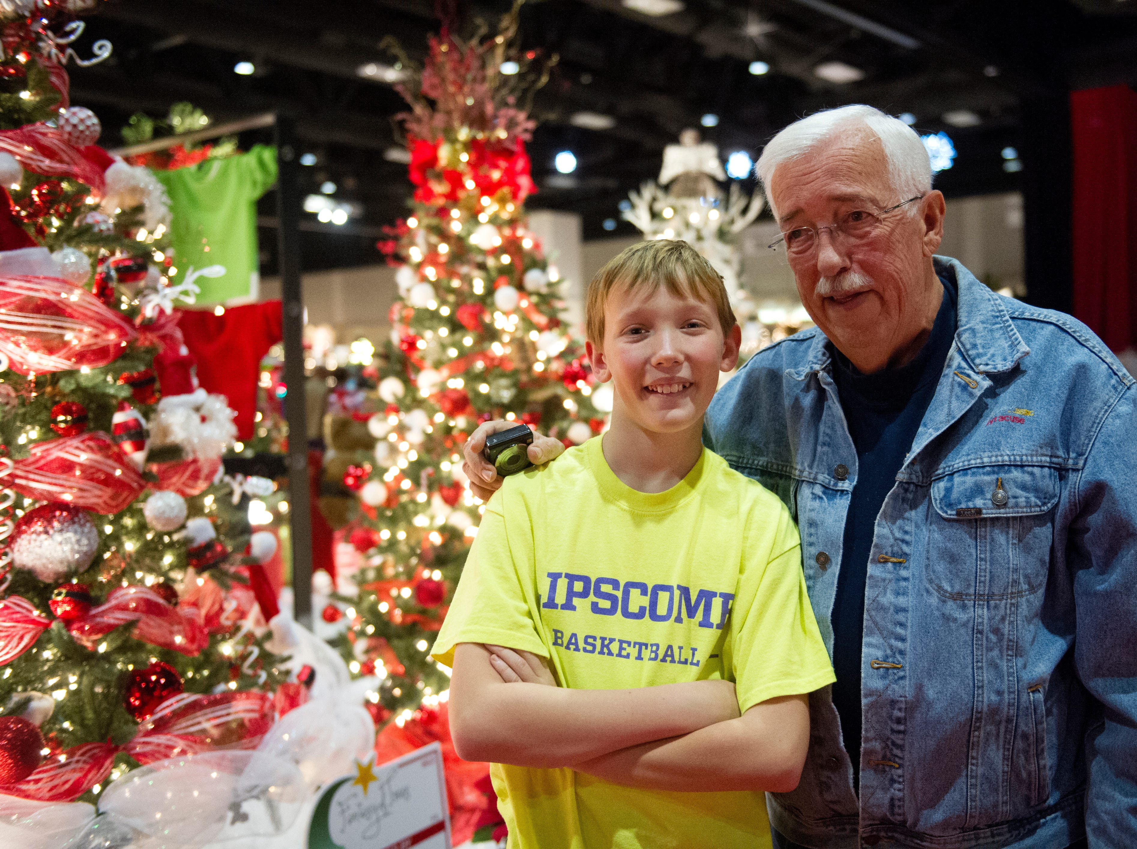 Charlie Lutz of Franklin poses for a photo with his grandfather William Milne of Tellico Village during the Fantasy of Trees at the Knoxville Convention Center Wednesday, Nov. 25, 2015. (JESSICA TEZAK/NEWS SENTINEL)