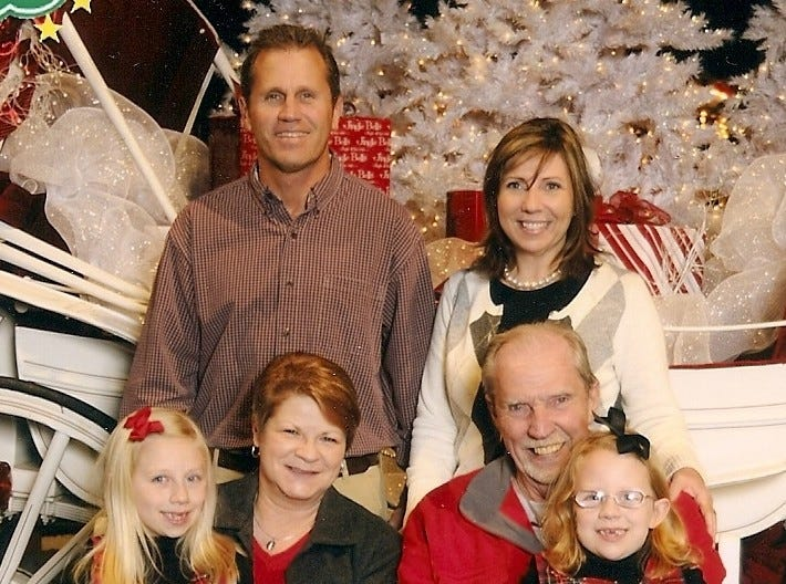 """The Roark family attended this year's Fantasy of Trees. Seated from left, are daughter Mary Roark, 7, Pam Hopper, """"Papaw"""" Jim Young, and daughter Sophie Roark, 5; standing are Max Roark and wife LeAnne."""