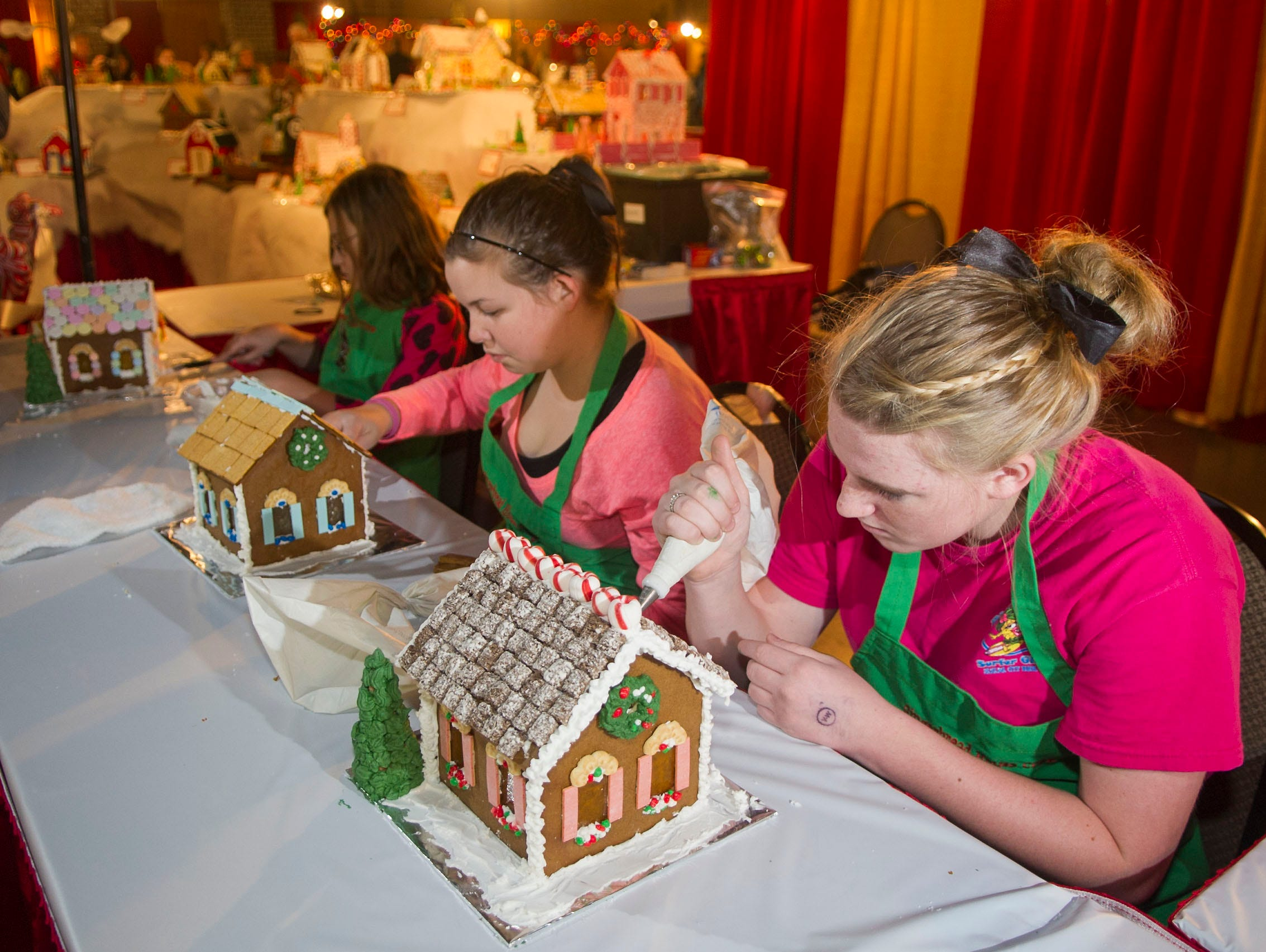 Students from Greenback schools create gingerbread houses at the Fantasy of Trees.   The students started after Halloween making trees and continue making gingerbread housed throughout the event.Amanda Spafford, 11, left, Brittany Clark, 14 center, and Emily Spafford, 15, right.The 28th Fantasy of Trees once again transforms the downtown Knoxville Convention Center into a winter wonderland of decorated trees, gingerbread houses, holiday shops and children's activities, helping move Thanksgiving week into the Christmas season. ( J. MILES CARY/NEWS SENTINEL )