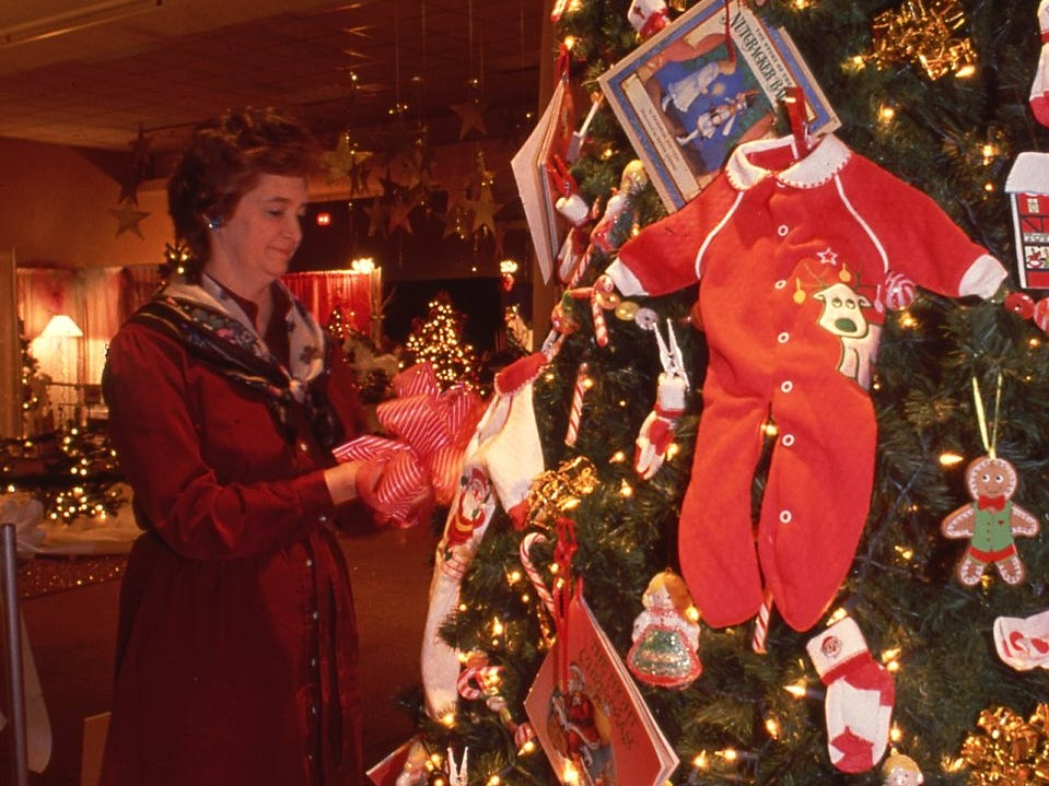 Rita Hiers puts the final touches on a tree sponsored by Dr. John Madox for Fantasy of Trees, November, 1990.