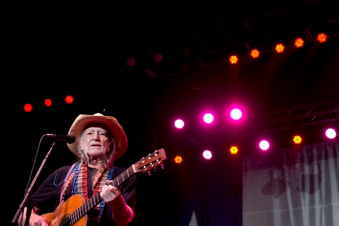 Willie Nelson performs at Thompson-Boling Arena on Sunday, July 20, 2014.