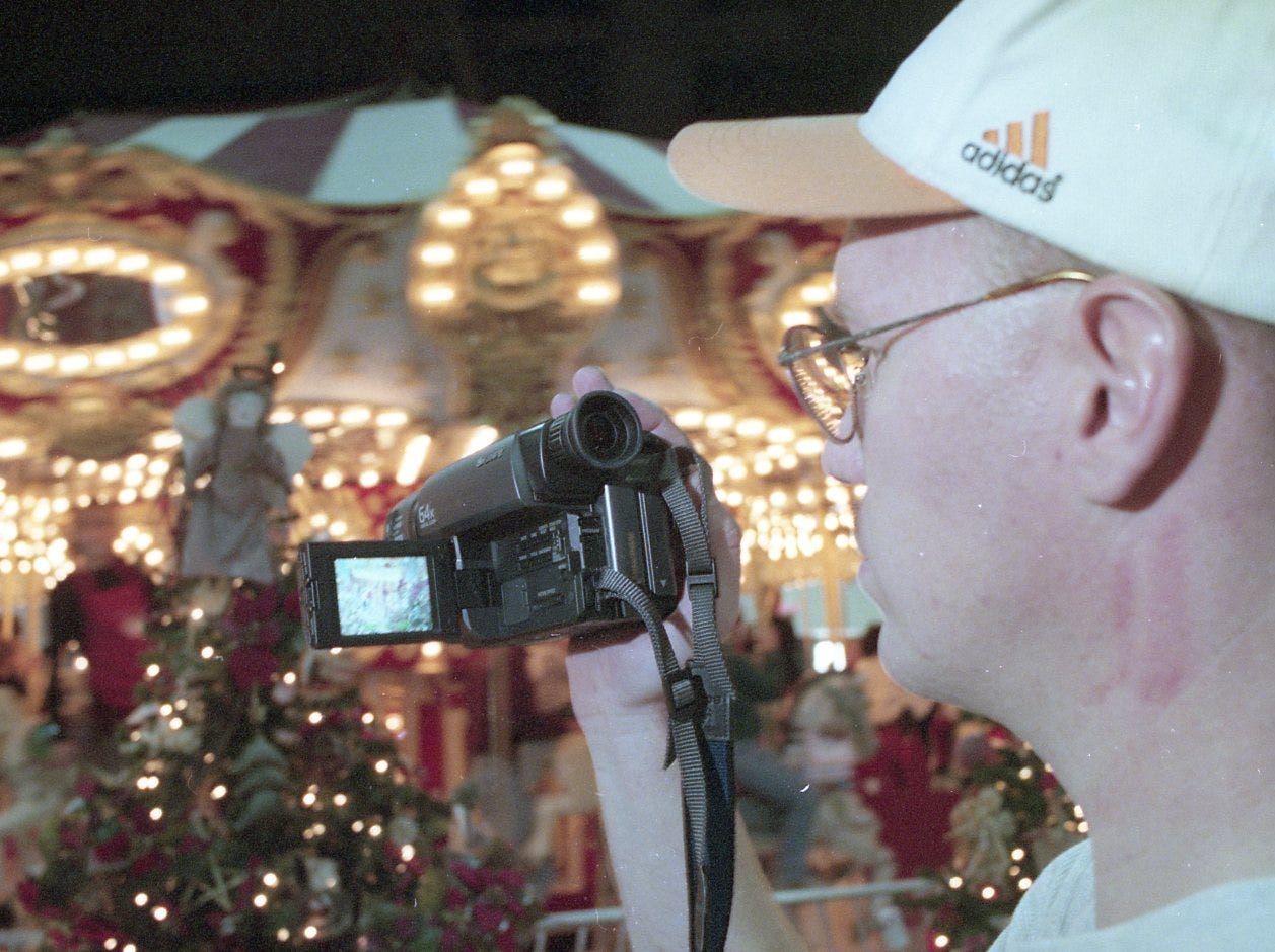Chris Surber video tapes his wife, Cristy and son, Zachary on the carousel during the 14th annual Fantasy of Trees, November, 1998.