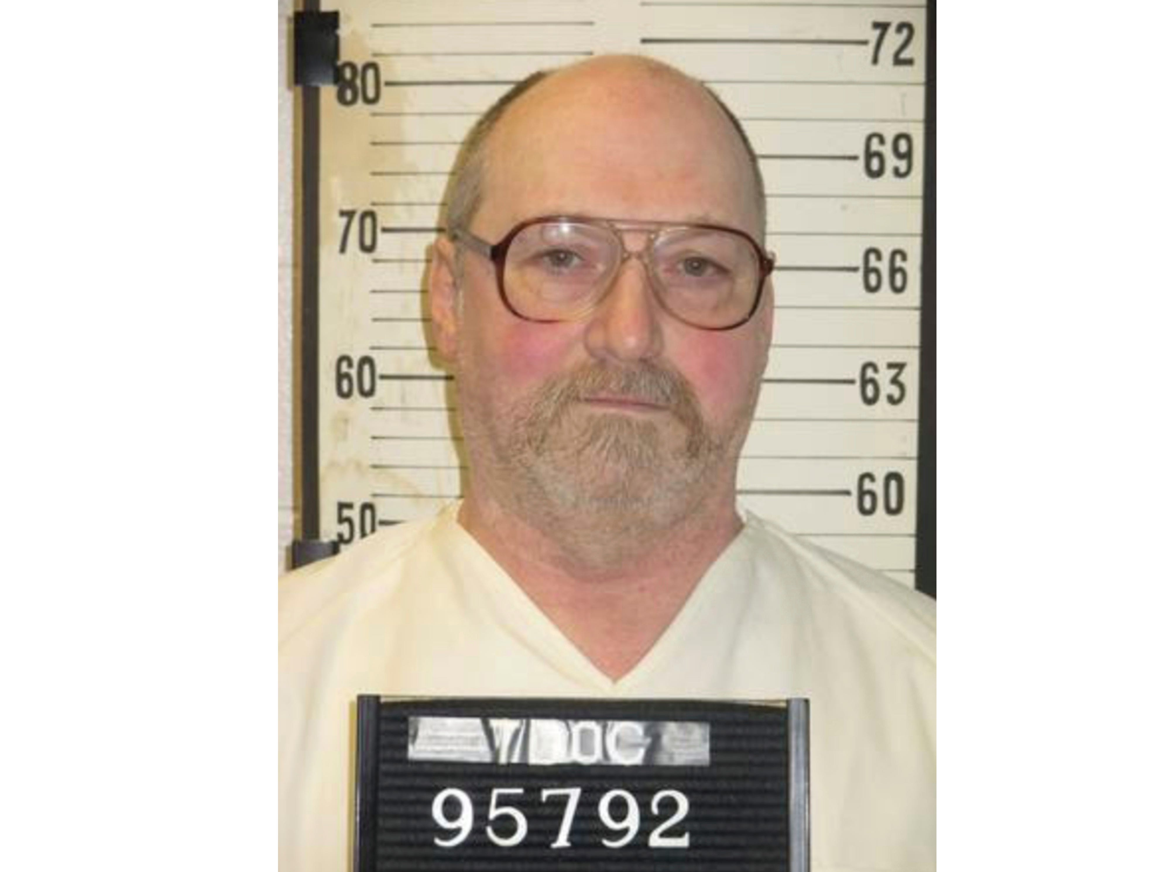 FILE - This undated file photo provided by the Tennessee Department of Correction shows inmate David Earl Miller in Nashville, Tenn. Tennessee death row inmate Miller faces a Tuesday afternoon, Nov. 20, 2018, deadline to inform prison officials whether he wants to be executed by lethal injection or electrocution. Miller is scheduled to die on Dec. 6 for the 1981 murder of 23-year-old Lee Standifer in Knoxville. (Tennessee Department of Correction via AP, File)