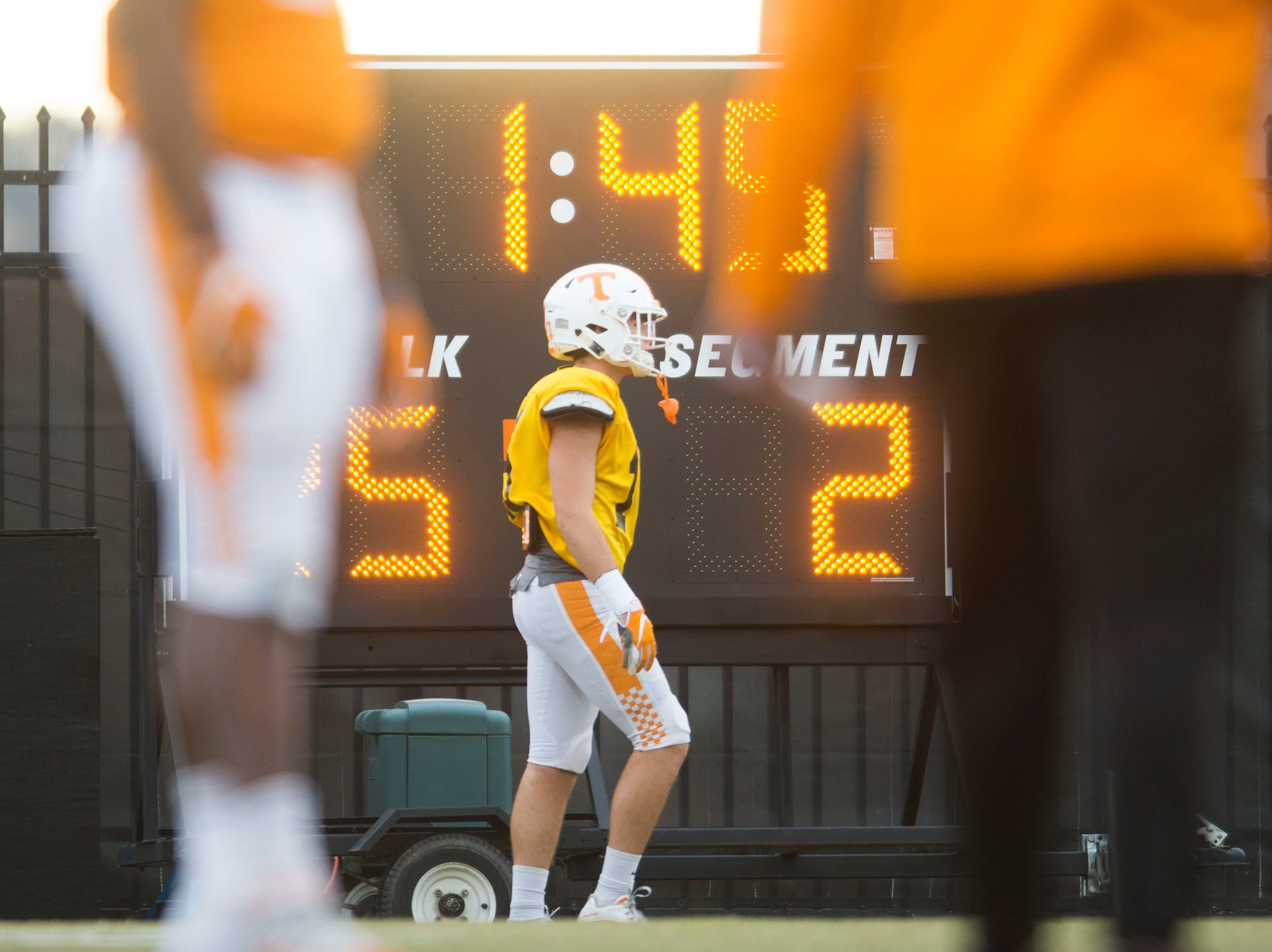 Players stand on the field at a University of Tennessee football practice Tuesday, Nov. 20, 2018.