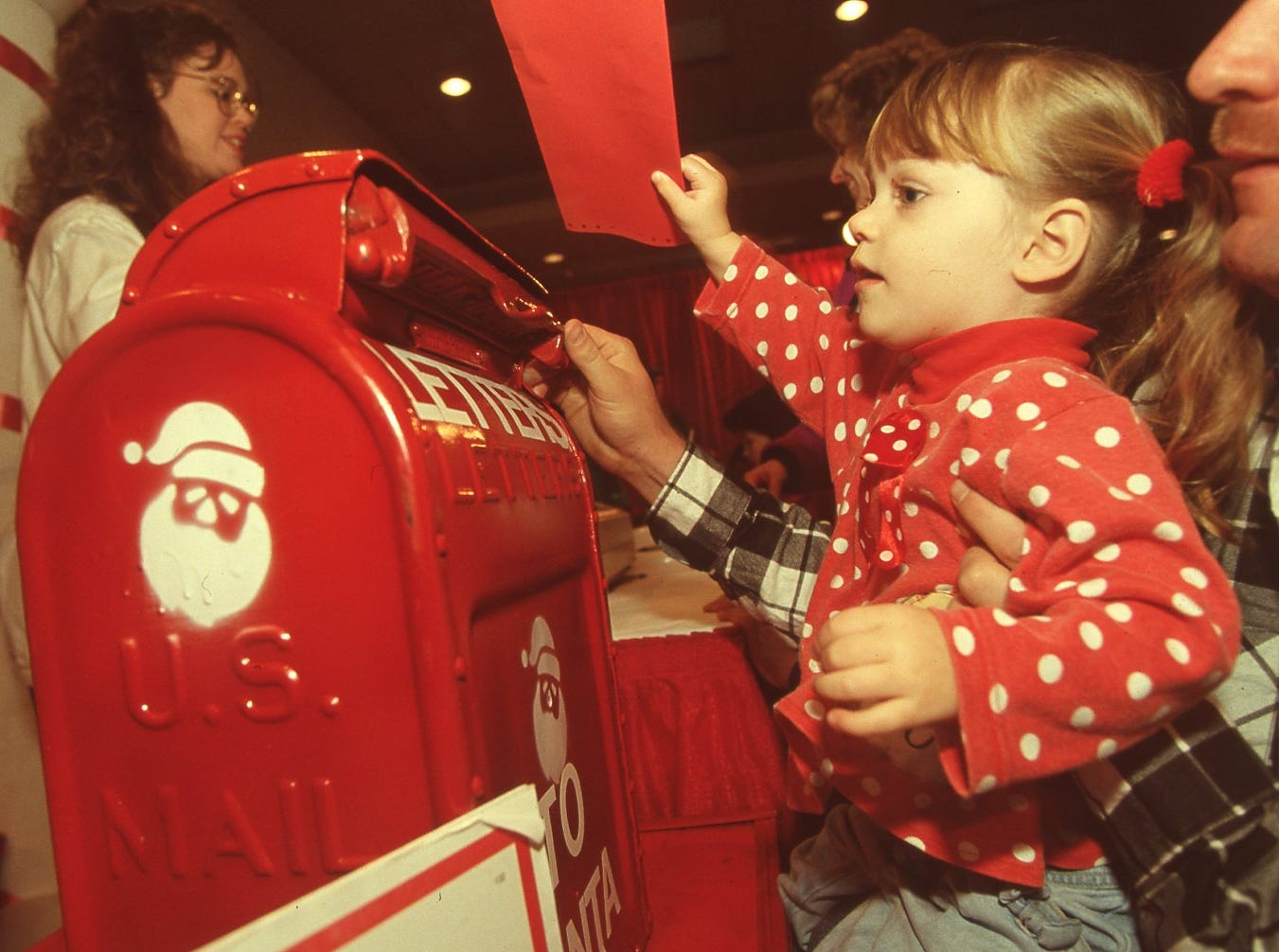 Amanda Kidd of Seymour mails a letter to Santa with help from her dad, Billy, at Fantasy of Trees, November, 1995.