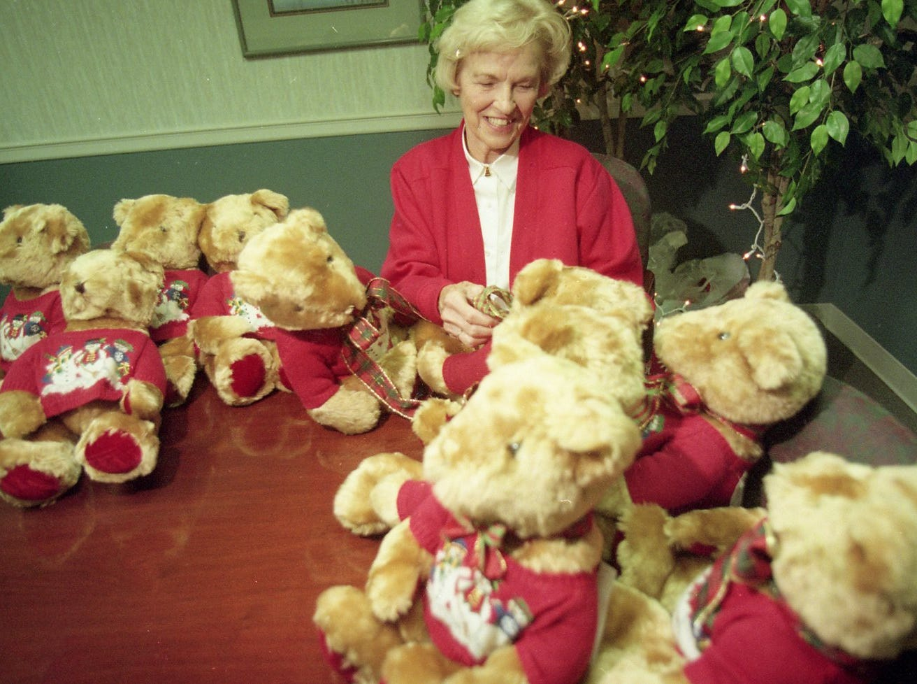 Peg Parker, who served as the first co-chair of Fantasy of Trees, puts ribbons on stuffed bears at Children's Hospital that will be part of this years tea, 1999.
