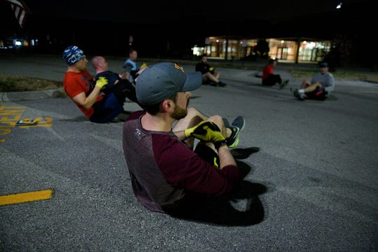 Jason Good and other F3 Knoxville men exercising Tuesday, Nov. 20, 2018 in the parking lot of Powell High School. F3 stands for fitness, fellowship, and faith and is multiple groups of men who gather in nine locations around Knoxville for accountability and exercise.