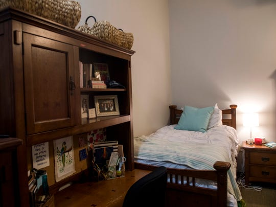 A woman's bedroom inside The Knoxville Fellows' Market Square apartments in downtown Knoxville.