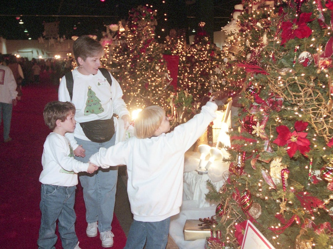 Amy Sallings escorts her son, Jonathan, left, and friend Travis Franklin through Fantasy of Trees, November, 1999.