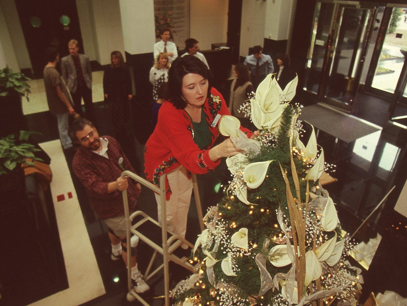 Teresa Goddard, Children's Hospital director of annual giving makes the final adjustments to the White Lily tree from the 1995 Fantasy of Trees.
