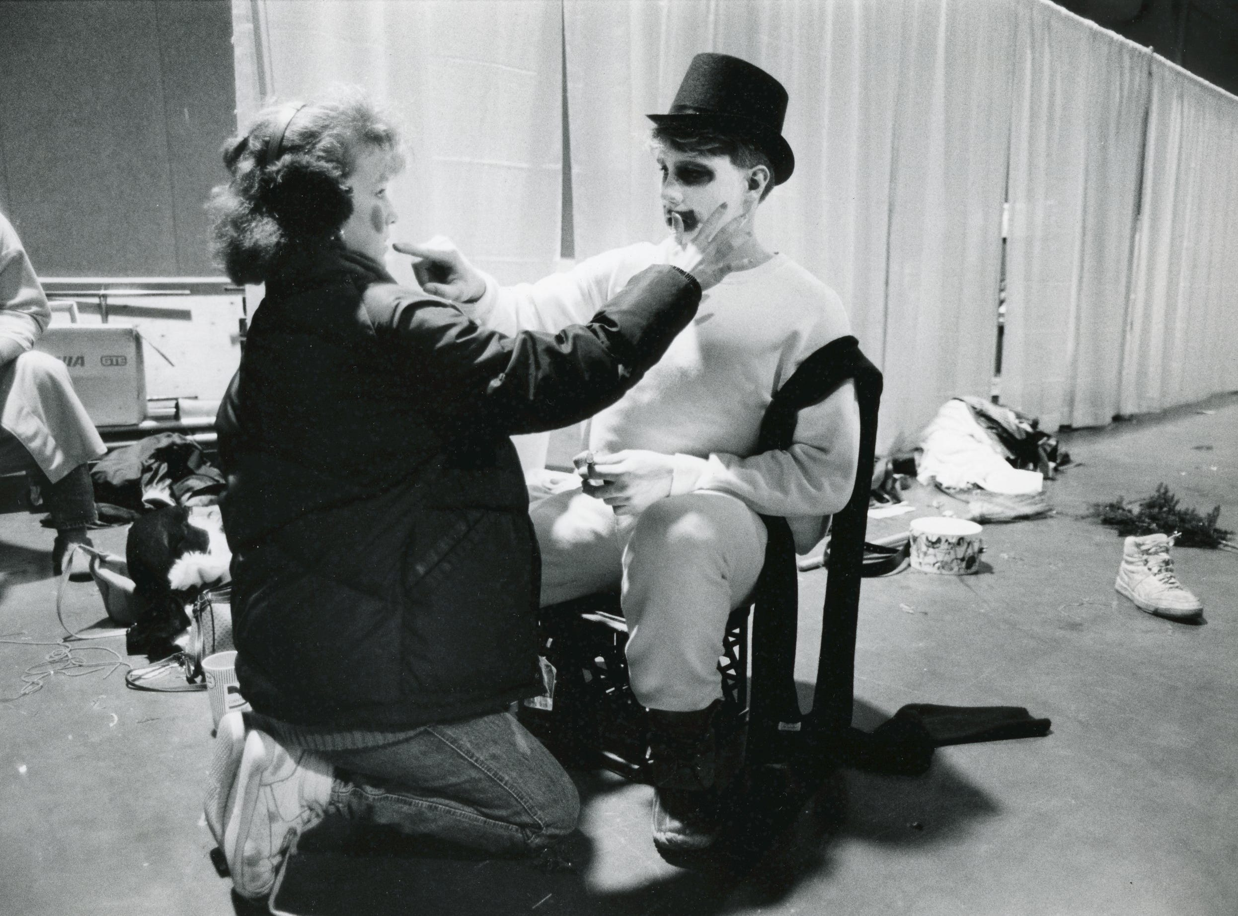 Bearden High drama students Marsha Jones and Gene Haun, assist one another with make up for a skit at Fantasy of Trees, November 1987.