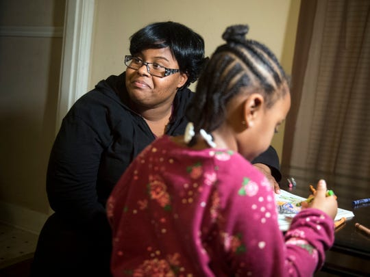 Vanicia Vance and daughter Z'niyah color at home Monday, Nov. 19, 2018. Vance is a single mother who works in home health care and is attending college. She is receiving an Empty Stocking Fund basket this year.