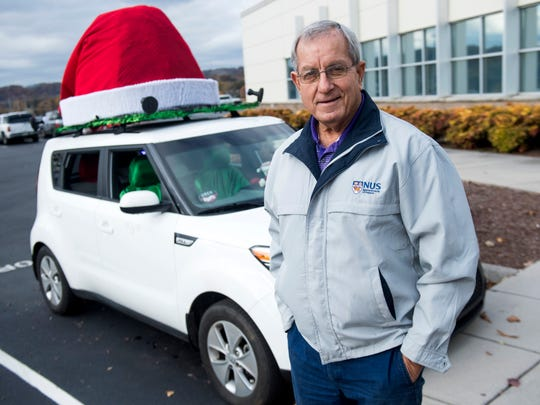 David Weech with his Christmas-themed Kia Soul outside of the Knoxville News Sentinel on Tuesday, November 20, 2018. Weech drives his Christmas-themed car for Uber and Lyft.