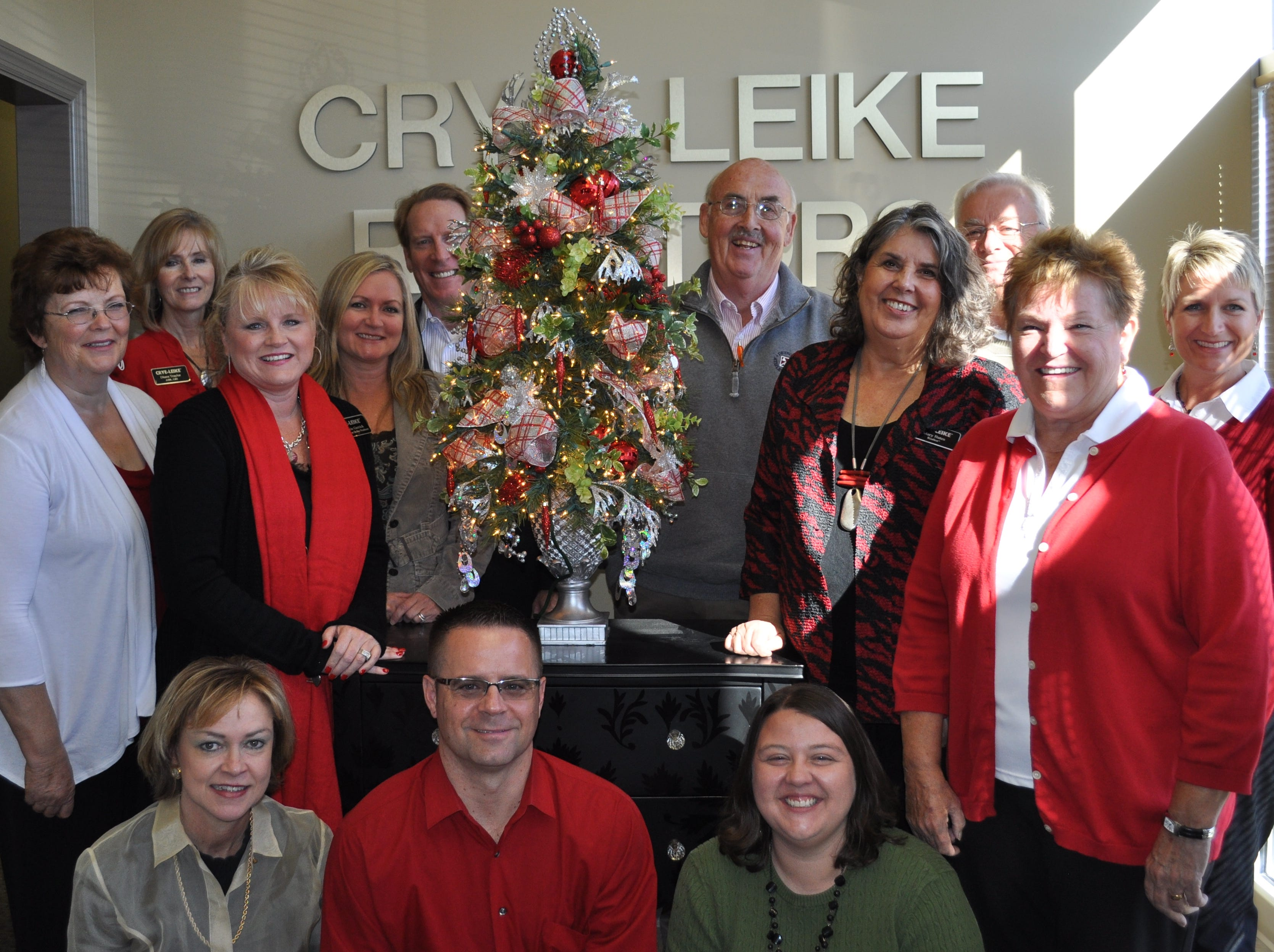 Crye-Leike Realty has donated and decorated a tree that will be sold to raise funds for the Fantasy of Trees. Realty agents are, first row, from left, Anita Vines, David Gibson, Office Administrator Cassie Riconoscuito; second row, Mary Coffey, Marie Gerrick, Jamie Seal, Mary Bates, Lynn Brown, Melonie Carideo; third row, Diana Traylor, Michael Swenor, Jere Krieg and Bob Warner.
