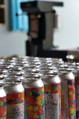 Pictured are cans of New Kids on the Floc, a New England double IPA that will be available for a limited time only at Pretentious Beer Co. starting Nov. 24.