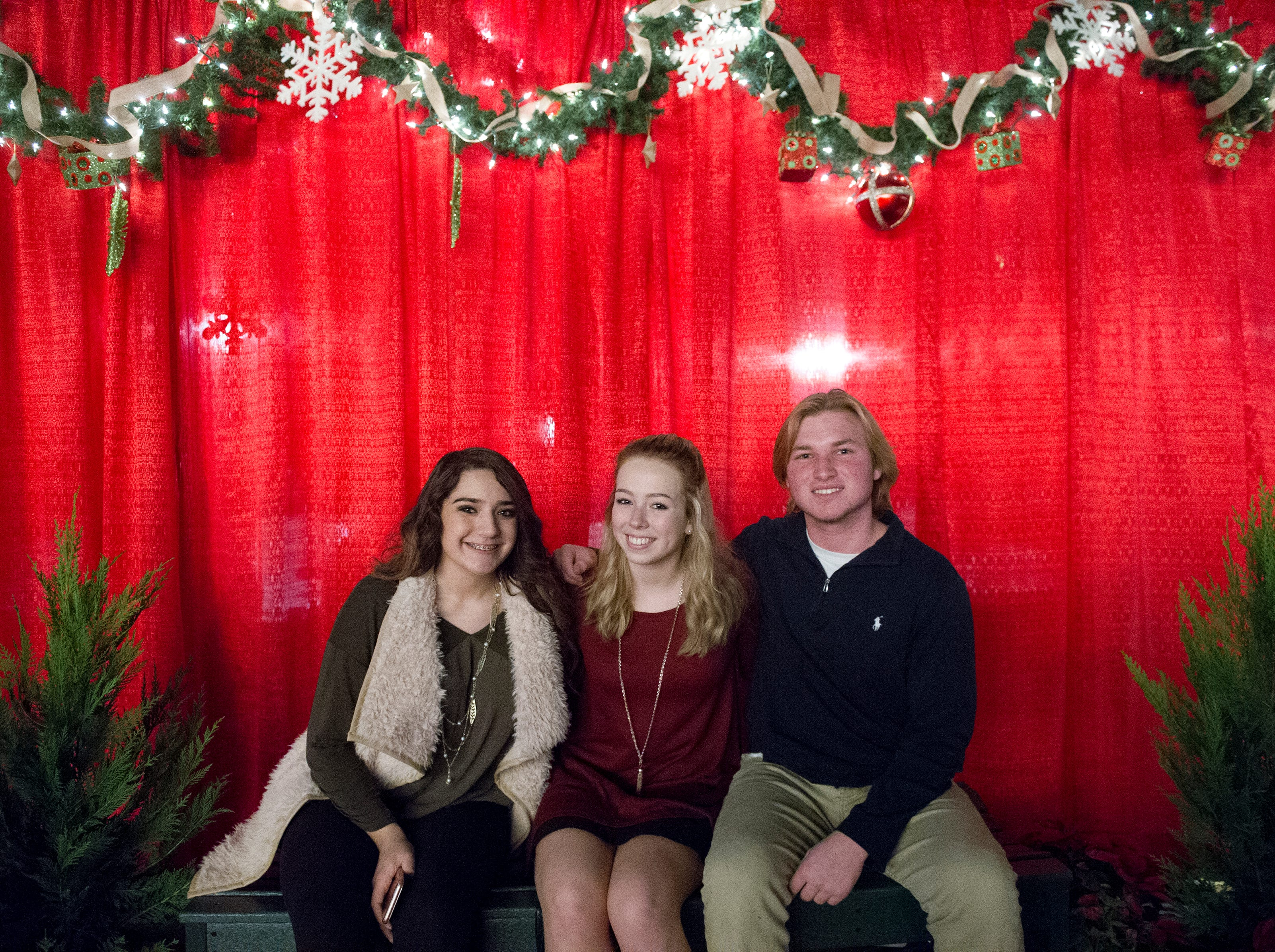 Isabella Saravi (from left), Olivia Clevenger, and Tristan MacFawn all of Knoxville pose for a photo during the Fantasy of Trees at the Knoxville Convention Center Wednesday, Nov. 25, 2015. (JESSICA TEZAK/NEWS SENTINEL)