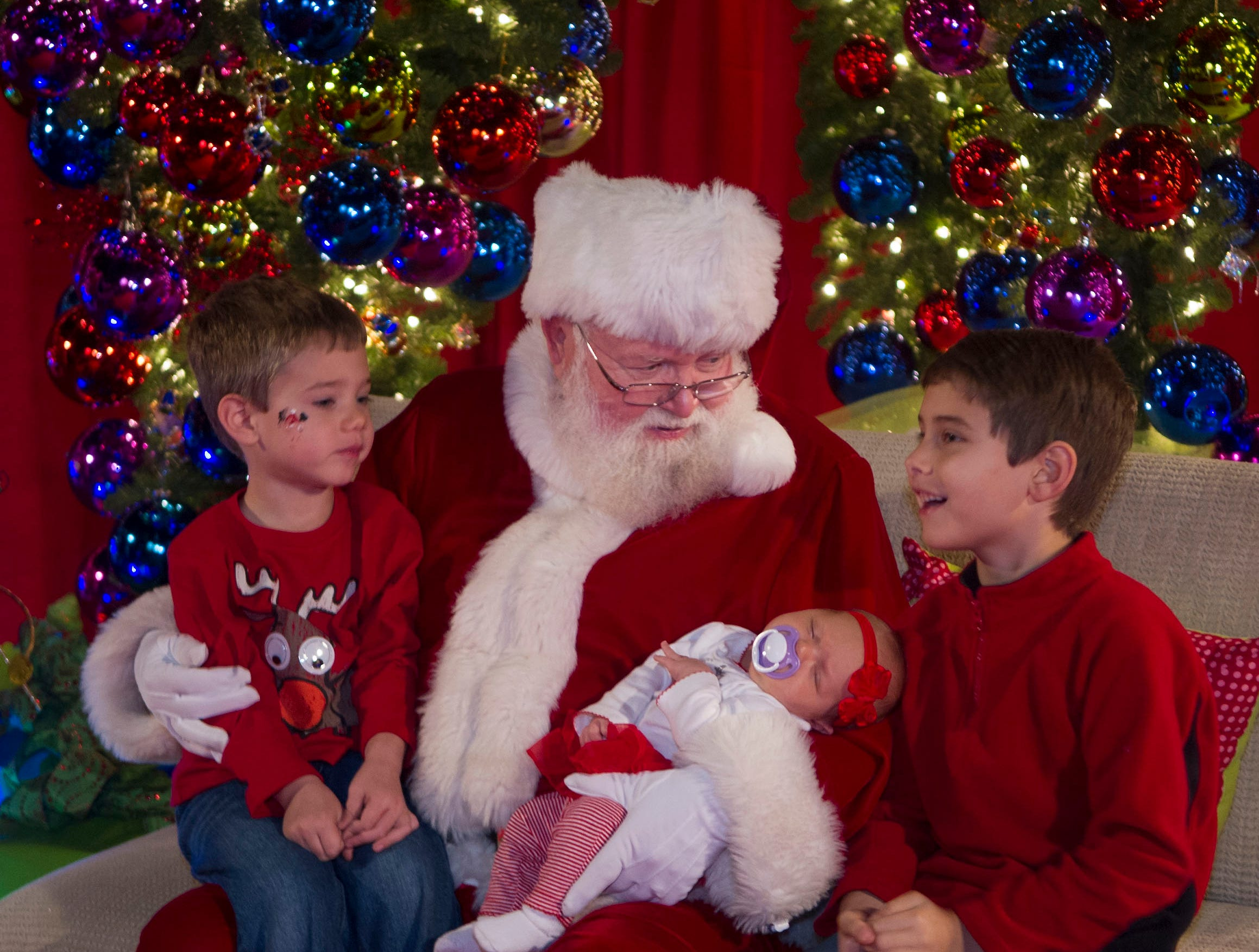 The Lunsford children from Karns give Santa Claus their Christmas wishes at the Fantasy of Trees.   Daniel Lunsford, 3, left, Santa, Samantha Lunsford 1 month old and Adam Lunsford, 6, right.The 28th Fantasy of Trees once again transforms the downtown Knoxville Convention Center into a winter wonderland of decorated trees, gingerbread houses, holiday shops and children's activities, helping move Thanksgiving week into the Christmas season. ( J. MILES CARY/NEWS SENTINEL )
