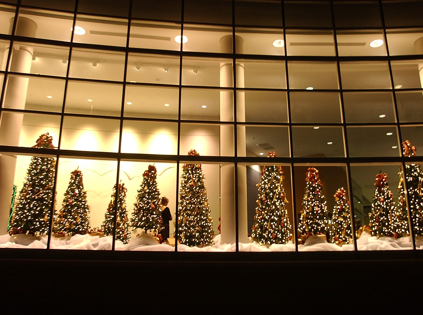 fantasytrees1.CC#63.jpg-----living---The windows of the Knoxville Convention Center were decorated with Christmas trees to celebrate the 19th annual Fantasy of Trees, which benefits the East Tennessee Children's Hospital.Photo by Cathy Clarke, Knoxville News Sentinel