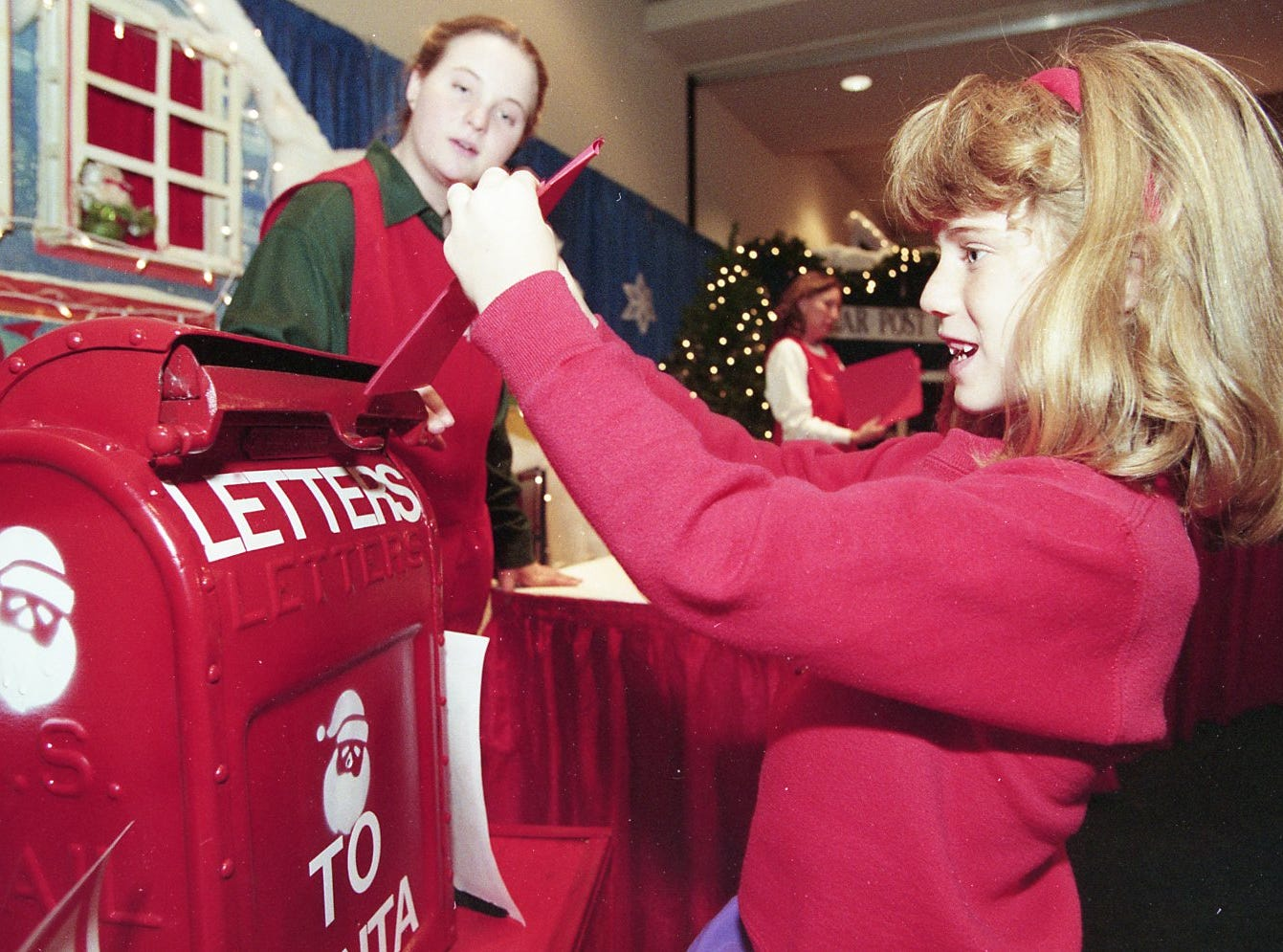 Katie Campbell mails a computerized letter to Santa during the 10th annual Fantasy of Trees, November 1994.