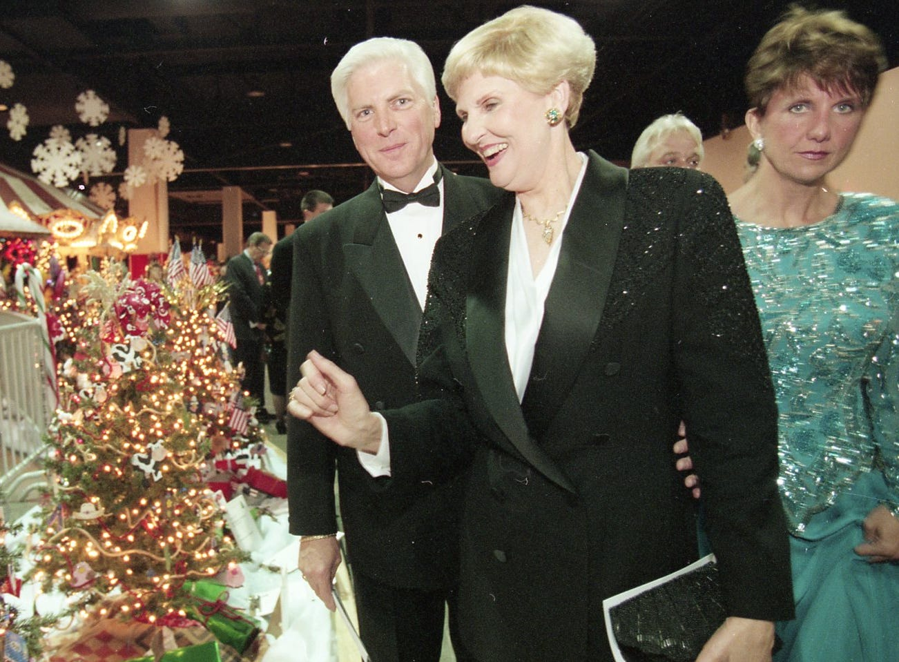 Art Mayfield of Gifts & Co. and Sally Rogers of All Knox Floral look at the decorated trees with an eye towards buying at Fantasy of Trees, 1996.