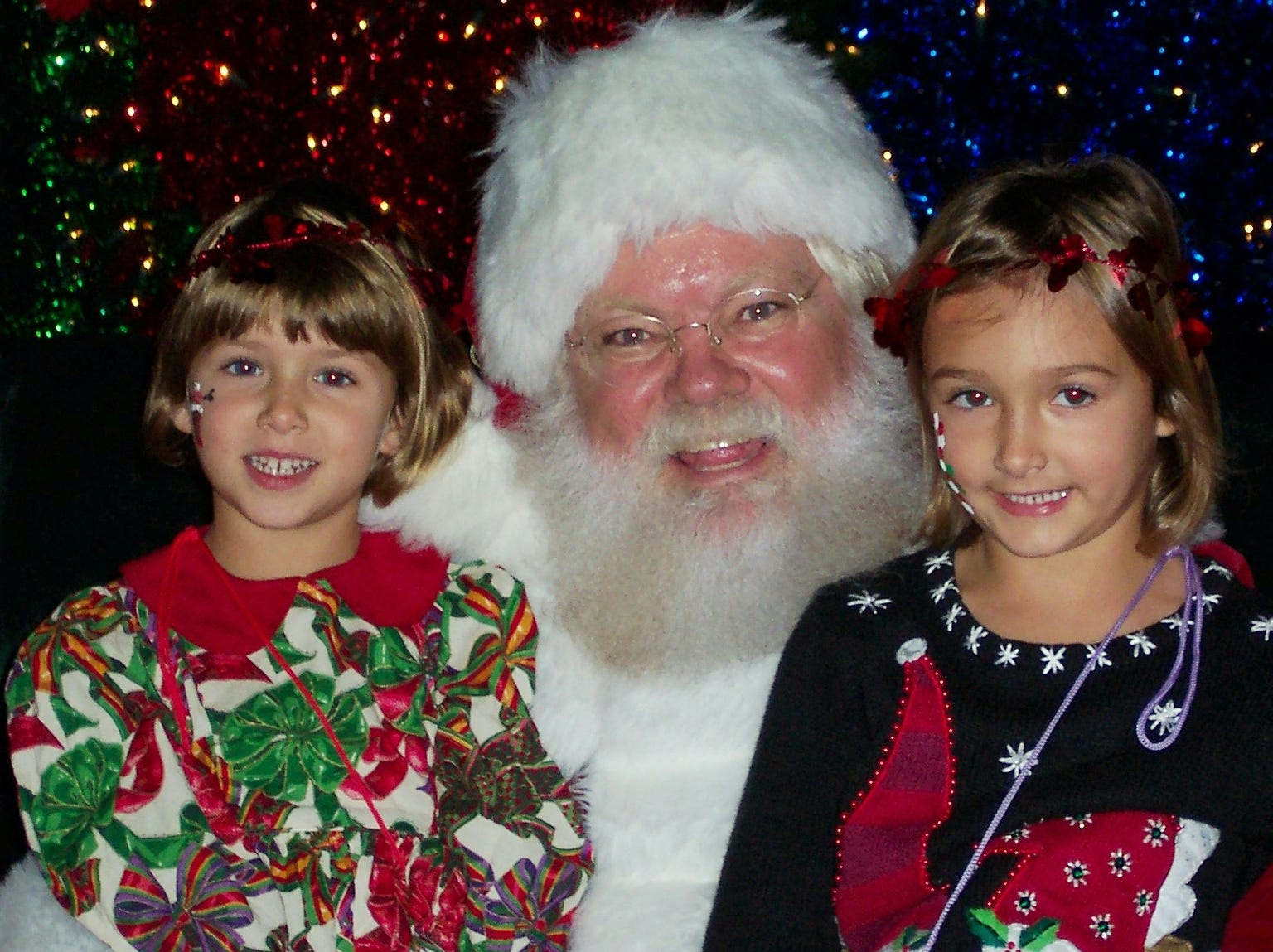 Payton and Jordan Todd, ages 4 and 5, chatted with Santa at the Fantasy of Trees Nov. 24. Payton and Jordan are the daughters of Bill and Eva Todd.