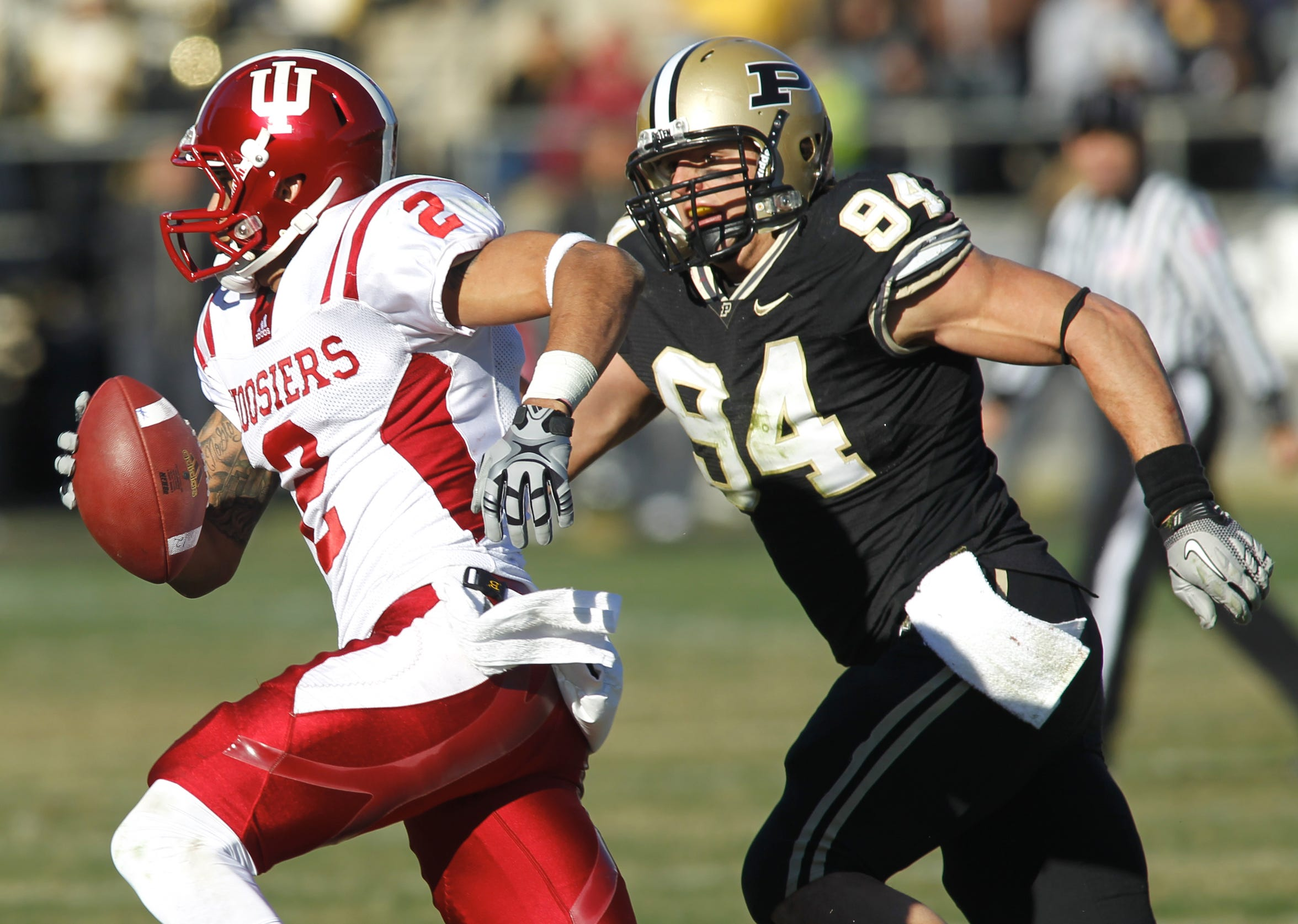 Purdue defensive end Ryan Kerrigan (94) earned All-America status with his penchant for forcing fumbles and collecting quarterback sacks.