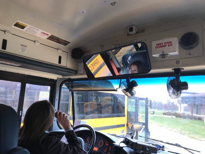 """TSC bus driver Michelle Collins tells her students to """"sit on their pockets"""" before leaving the Wea Ridge Middle School parking lot."""