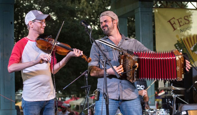 Courtney Granger, left, and Wilson Savoy of the Pine Leaf Boys perform Wednesday at the last Downtown Alive! of the fall season.
